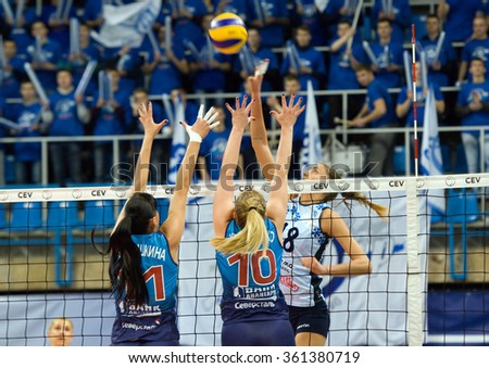 MOSCOW - DECEMBER 2: E. Kosyanenko (10) and E. Lubushkina (11) defend on a game Dynamo MSK vs Dynamo KZN on Russian National women Volleyball tournament on December 2, in Moscow, Russia, 2015 - stock photo