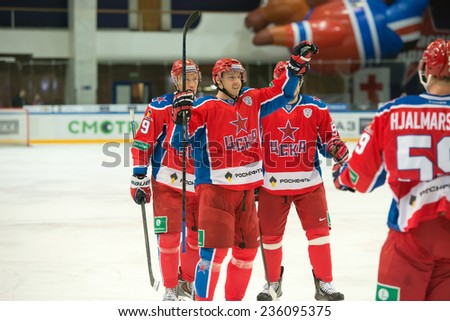 MOSCOW - DECEMBER 3: Hockey players CSKA rejoice scored a goal on game CSKA vs Severstal on Russian KHL premier hockey league Championship on December 3, 2014, in Moscow, Russia. CSKA won 9: 1 - stock photo