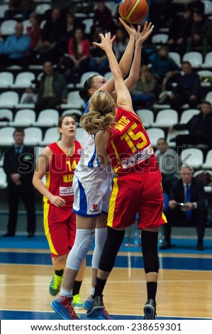 MOSCOW - DECEMBER 4, 2014: K. Antic (15) defense during the International Europe bascketball league match Dynamo Moscow vs Maccabi Ashdod Israel in Moscow, Russia. Dynamo loss 59:67 - stock photo
