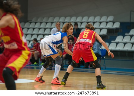 MOSCOW - DECEMBER 4, 2014: K. Keyru (4) atack on the International Europe bascketball league match Dynamo Moscow vs Maccabi Ashdod Israel in sport palace Krilatskoe, Moscow, Russia. Dynamo loss 59:67 - stock photo