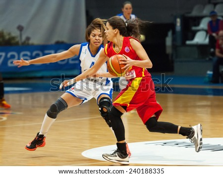 MOSCOW - DECEMBER 4, 2014: K. Keyru (4) defense on the International Europe bascketball league game Dynamo Moscow vs Maccabi Ashdod Israel in sport palace Krilatskoe, Moscow, Russia. Dynamo loss 59:67 - stock photo