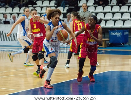 MOSCOW - DECEMBER 4, 2014: Katerina Keyru (4) dribble during the International Europe bascketball league match Dynamo Moscow vs Maccabi Ashdod Israel in Moscow, Russia. Dynamo loss 59:67 - stock photo