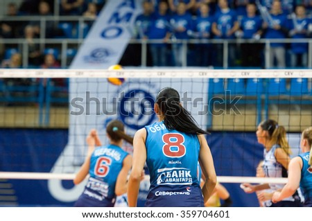 MOSCOW - DECEMBER 2: N. Obmochaeva (8) in action on a game Dynamo MSK vs Dynamo KZN on Russian National women Volleyball tournament on December 2, in Moscow, Russia, 2015 - stock photo