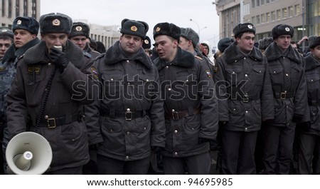 MOSCOW - DECEMBER 24: Policemen with megaphone at work. The biggest protest in Russia for the last 20 years.  December 24, 2011 in Moscow, Russia. - stock photo