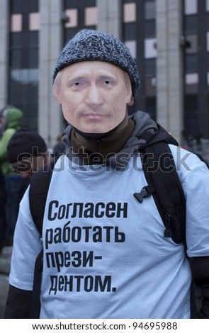 "MOSCOW - DECEMBER 24: Protester against the election results with Putin's mask on his face and text on his t-shirt: ""I am ready to work as a President"". December 24, 2011 in Moscow, Russia. - stock photo"