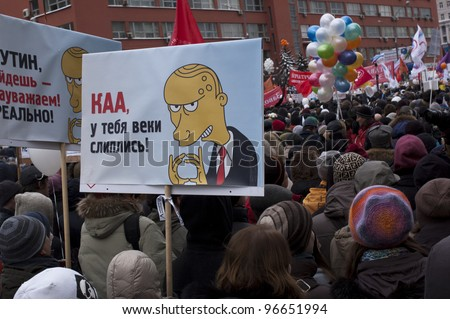 "MOSCOW - DECEMBER 24:Protesters hold up a sign that reads ""Kaa,your eyes are stick together"" (quote from ""Maugli"") and Putin's face in Simpson's style. The protest is against election results on December 24, 2011 in Moscow,Russia - stock photo"