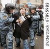 MOSCOW - DECEMBER 27: Russian police detain a supporter of Yukos oil company chief executive officer Mikhail Khodorkovsky during a rally outside the court December 27, 2010 in Moscow, Russia. - stock photo