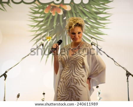 MOSCOW - DECEMBER 26: Russian singer Maria Maksakova sing a song on a New Year concert on December 26, 2013 in Moscow, Russia - stock photo