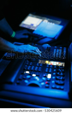 MOSCOW - 3 DECEMBER,2016: Sound technician and lights technicians control the music show in night club.Professional audio,light mixer controller panel.Pro equipment for concerts.Stage lighting control