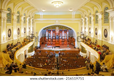 MOSCOW - DECEMBER 21: Spectators taking places in the Big Hall of Moscow Conservatory before a classical music concert on December 21, 2014 in Moscow. - stock photo