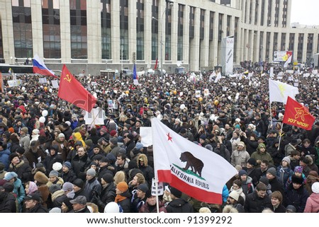 MOSCOW - DECEMBER 24: 100 thousands in Moscow protest Putin and election results on Sakharov Avenue. Biggest protest in Russia for the last 20 years, December 24, 2011 in Moscow, Russia. - stock photo
