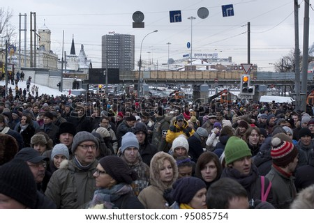 MOSCOW - DECEMBER 24:  120 thousands of protesters take to in Academician Sakharov Prospect. Protest against election results. December 24, 2011 in Moscow, Russia. - stock photo