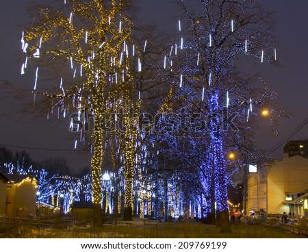 MOSCOW - DECEMBER 30, 2013: trees on Pushkinskaya square illuminated for Christmas and New Year holidays. - stock photo