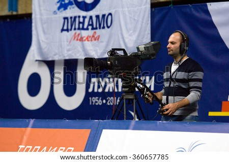 MOSCOW - DECEMBER 2: Unidentified camera man shooting on a game Dynamo MSK vs Dynamo KZN on Russian National women Volleyball tournament on December 2, in Moscow, Russia, 2015 - stock photo