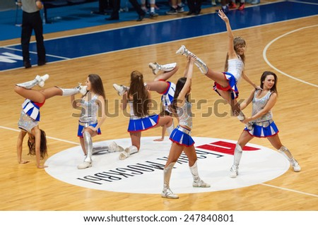 MOSCOW - DECEMBER 4, 2014: Unidentified cheerleaders dance during the International Europe bascketball league match Dynamo Moscow vs Maccabi Ashdod Israel in sport palace Krilatskoe, Moscow, Russia - stock photo