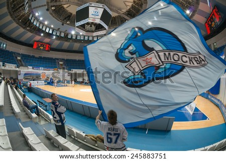 MOSCOW- DECEMBER 4, 2014:  Unrecognized fans of the club Dynamo on the International Europe bascketball league match Dynamo Moscow vs Maccabi Ashdod Israel in sport palace Krilatskoe, Moscow, Russia. - stock photo