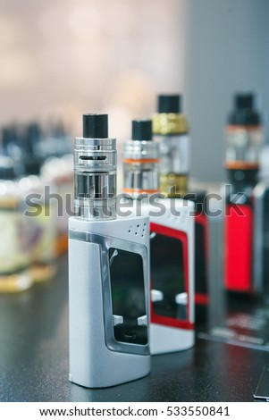 MOSCOW - 9 DECEMBER,2016: Vape store.vaper device mod shop.Modern vaporizer e-cig device,spare parts.New device model,micro coil clearomizer.Quit smoking nicotine cigarette,start vaping safe ecig vape