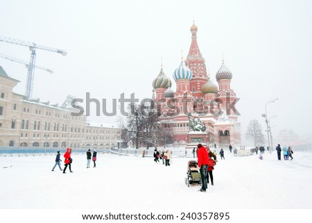 MOSCOW - DECEMBER 25, 2014: View of the Red Square in Moscow at snowstorm. A popular touristic landmark. UNESCO World Heritage Site.  - stock photo
