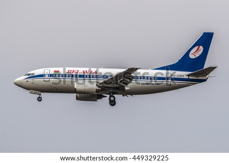 Moscow, Domodedovo airport, Russia - April 24, 2013:  Boeing 737-500 EW-251PA Belavia landing at Domodedovo international airport