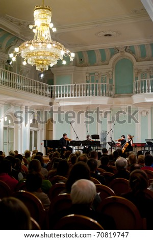 """MOSCOW - FEB 8: The audience listens to a 11-th concert of the series """"Contemporary Polish Music"""" Ensemble Studio New Music in  Moscow Conservatory on February 8, 2010 in Moscow, Russia - stock photo"""