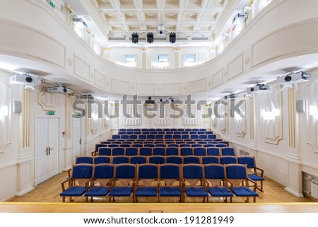 MOSCOW - FEB 10: View of an empty theatre with blue seats and balcony on february 10, 2014 in Moscow. In Moscow there are many halls for classical music - stock photo