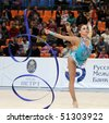 MOSCOW - FEBRUARY 20: An unidentified participant in action at International Tournament in Rhythmic Gymnastics Grand Prix Cup champions Gazprom, February 20, 2010 in Moscow, Russia. - stock photo