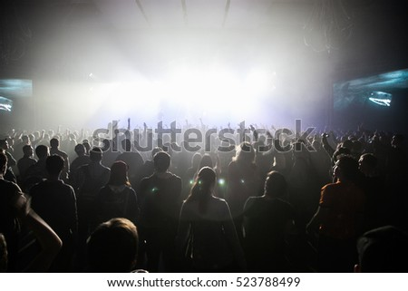 MOSCOW-20 FEBRUARY,2015: Crowd of music fans rave on electronic music festival in nightclub.Clubbers rave in music hall to trap dj concert.Concert audience enjoy show.Edm music festival.Techno party