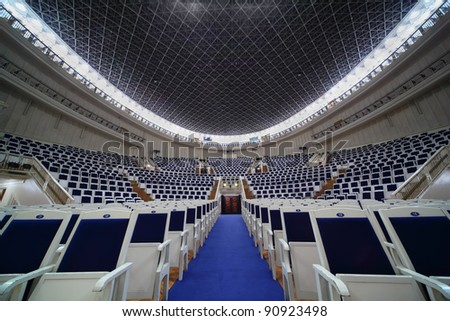 MOSCOW - FEBRUARY 26: Empty chairs in Tchaikovsky Concert Hall, on February 26, 2011 in Moscow, Russia.  Each year, over three hundred concerts are held on stage of Tchaikovsky Concert Hall. - stock photo