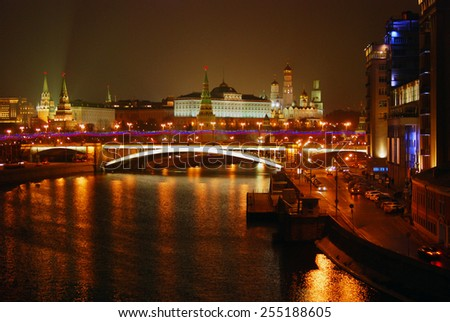 MOSCOW - FEBRUARY 22, 2015: Moscow Kremlin. Night scene. The Moscow river embankment. The bridge over the Moscow river. Moscow Kremlin is a UNESCO World Heritage Site.