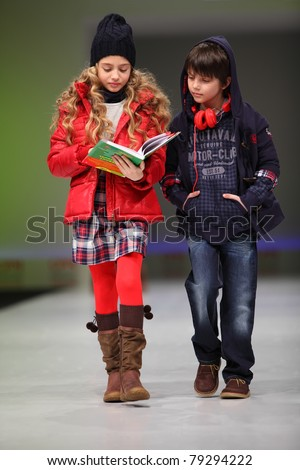 MOSCOW - FEBRUARY 22: Unidentified child models wear fashions from Snowimage and walk the catwalk in Collection Premiere Moscow, an international fashion fair for Eastern Europe, on February 22, 2011 in Moscow, Russia - stock photo