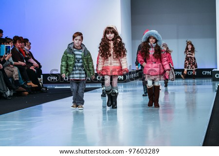 MOSCOW-FEBRUARY 29: Unidentified children wear Boboli clothing collection at the international exhibition of  the fashion industry, Collection Premiere Moscow, CPM on February 29, 2012 in Moscow, Russia. - stock photo