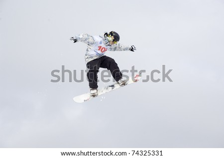 MOSCOW - FEBRUARY 28: unidentified sportsman at the Championship of Russia of snowboard, in discipline half-pipe and big-air in New-Peredelkino, Moscow on February 28, 2010 - stock photo