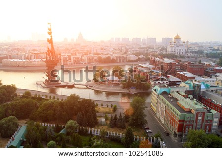 Moscow in the sunset light - General view from the top of the merging of the Moscow River and the Bypass canal in Moscow, monument to Peter I (left), The Cathedral of Christ the Savior (right) - stock photo