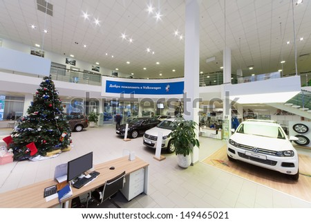 MOSCOW - JAN 11: Hall with cars and workplace in Volkswagen Center Varshavka on January 11, 2013, Moscow, Russia. Center offers a full range of cars Volkswagen - stock photo