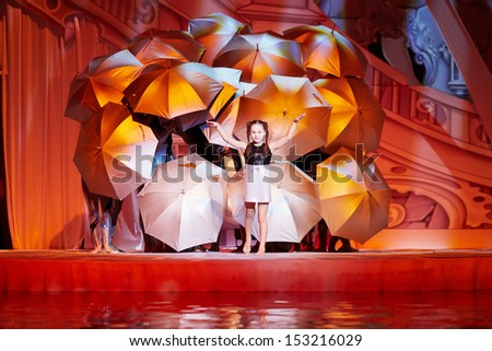 MOSCOW - JAN 8: Scene with umbrellas on stage at Swimming Pool of Sports complex Olympyisky during musical show Through the Looking Glass at school winter holidays, January 8, 2013, Moscow, Russia.