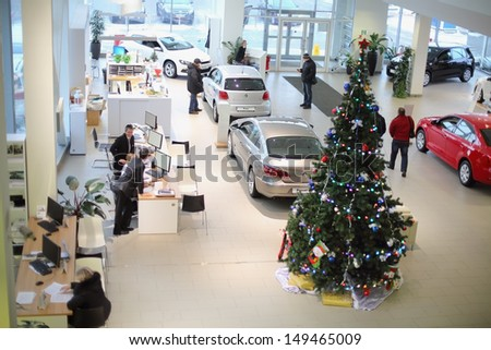 MOSCOW - JAN 11: Top view of the foyer with a reception and cars of Volkswagen Center Varshavka January 11, 2013, Moscow, Russia. Building of the center contains a three floor - stock photo