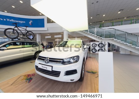 MOSCOW - JAN 11: Volkswagen Touareg in office of Volkswagen Center Varshavka on January 11, 2013, Moscow, Russia. The official dealer of Volkswagen Varshavka Center opened September 10, 2010 - stock photo