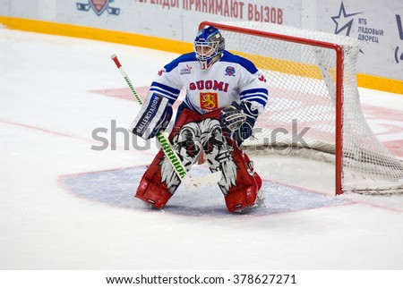 MOSCOW - JANUARY 29, 2016: Ari Sulander (31) in action on hockey game Finland vs Russia on League of World legends of Ice hockey championship in VTB ice arena, Russia. Russia won 6:2 - stock photo