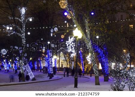 MOSCOW - JANUARY 04, 2014: Chistoprudniy boulevard (Chistiye prudi) illuminated for Christmas and New Year holidays. - stock photo