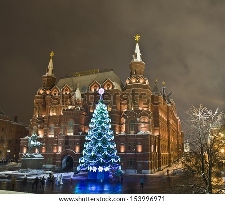 MOSCOW - JANUARY 09: christmas tree on Manezhnaya square and Historical museum, January 09, 2012, in town Moscow, Russia. - stock photo