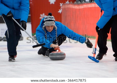 MOSCOW - JANUARY 17, 2016: Curling player Pavel Mishin in action on Russian Curling Champions Tour Moscow Classic 2016 on January 17, in Moscow, Russia, 2016 - stock photo