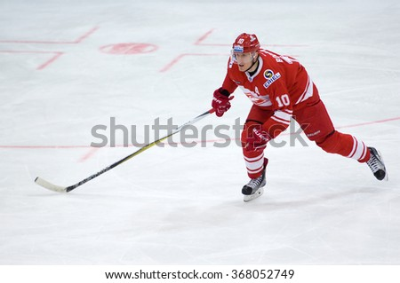 MOSCOW - JANUARY 15: Eugeny Bodrov (10) in action during hockey game Spartak vs Admiral on Russian KHL premier hockey league Championship on January 15, 2016, in Moscow, Russia. Spartak won 5:4