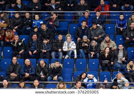MOSCOW - JANUARY 29, 2016: Fans and spectators on tribune during hockey game Sweden vs Czech on League of World legends of Ice hockey championship in VTB ice arena, Russia. Czech won 8:2 - stock photo