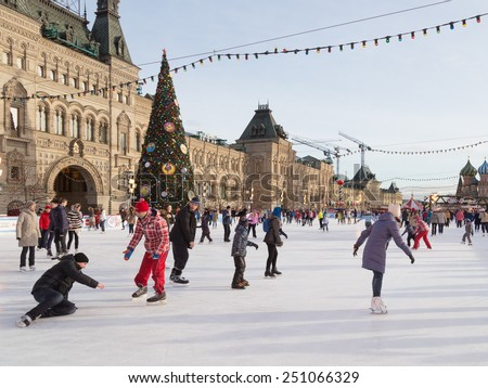 Moscow - 16 January 2015: Happy people skate on the rink skating on Christmas holidays on the Red Square and decorated Christmas tree Jan. 16, 2015, Moscow, Russia - stock photo