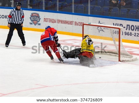 MOSCOW - JANUARY 29, 2016: J. Reznicek (9) scores during hockey game Sweden vs Czech on League of World legends of Ice hockey championship in VTB ice arena, Russia. Czech won 8:2 - stock photo
