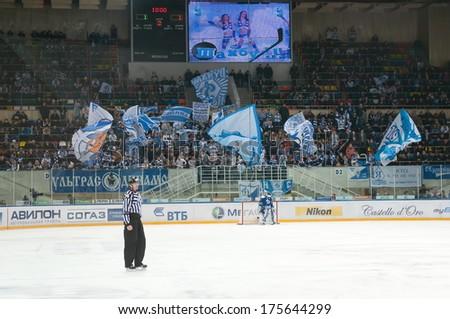 MOSCOW - JANUARY 28, 2014: Luzhniki Ice Arena and Unrecognized fans of the club Dynamo during the regular Hockey match Dynamo (Moscow) - Slovan (Bratislava) in sports palace Luzhniki. Final score 2:3 - stock photo