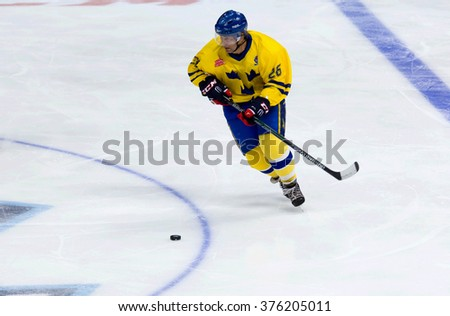 MOSCOW - JANUARY 29, 2016: Mats Naslund (26) in action during hockey game Sweden vs Czech on League of World legends of Ice hockey championship in VTB ice arena, Russia. Czech won 8:2 - stock photo