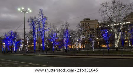 MOSCOW - JANUARY 01, 2014: trees illuminated for Christmas and New Year holidays on Theatre square. - stock photo