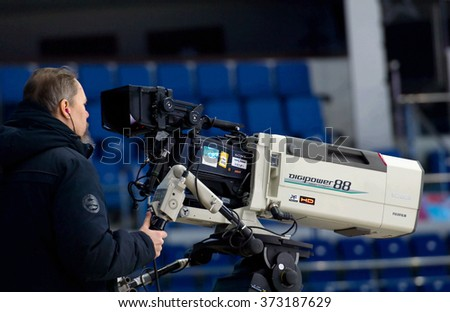 MOSCOW - JANUARY 29, 2016: Unidentified director filming hockey game Sweden vs Czech on League of World legends of Ice hockey championship in VTB ice arena, Russia. Czech won 8:2 - stock photo