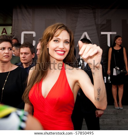 "MOSCOW - JULY 25: Actress Angelina Jolie at the premiere of the movie ""Salt"" at the ""October"" Cinema. July 25, 2010 in Moscow, Russia. - stock photo"